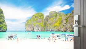 Opened wooden door to beautiful beach with tourist at maya bay,thailand. Opened wooden door to beautiful beach with tourist at maya bay, phi phi leh island royalty free stock photography