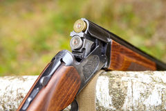 Opened wooden double-barreled hunting gun Stock Photography