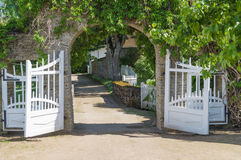 Opened wooden gate decorated with climbing plant Royalty Free Stock Photography
