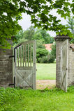 Opened wooden gate in park. Vertical view Royalty Free Stock Photography
