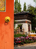 Opened wooden gate to Bhutan garden Stock Photos