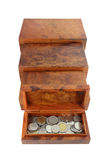 Opened wooden moneybox with coins Stock Image