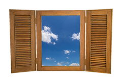Opened Wooden Window to View of Blue Sky on White Backg Royalty Free Stock Image