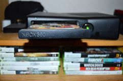Opened Xbox 360 with GTA 5 in it. Stock Image