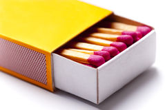 Opened yellow matchbox. Brand new opened yellow matchbox with many pink match sticks in it stock image