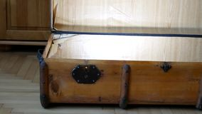 Opening the Antique flat top trunk. Large luggage. Opening the Antique flat suitcase. Large luggage stock video footage