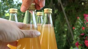 Opening a apple juice bottle. Video part of elder berry jam making. stock footage