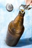 Opening beer Stock Photo