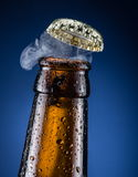 Opening of beer cap. Stock Image