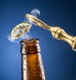 Opening of beer cap. Royalty Free Stock Image