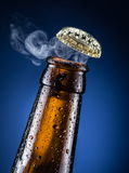 Opening of beer cap. Royalty Free Stock Images