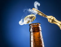 Opening of beer cap with a gas output. Royalty Free Stock Photo