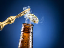 Opening of beer cap with the gas output. Stock Image