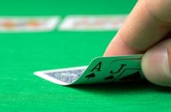 Opening blackjack. Closeup of hand opening blackjack royalty free stock images