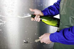 Opening a bottle of Champagne Stock Photos