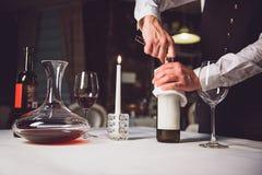Opening bottle of white wine Royalty Free Stock Photo