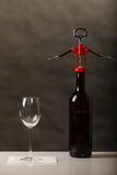 Opening of bottle of wine with corkscrew Stock Photo