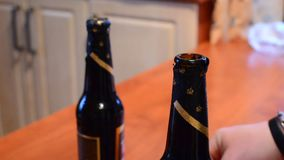 Opening the bottles stock footage
