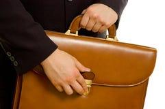 Opening briefcase Stock Photos