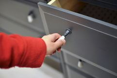 Opening cabinets Stock Image