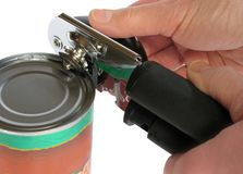 Opening a can. Isolated closeup of hand opening a can Royalty Free Stock Photos
