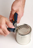 Opening a can with opening can Stock Image