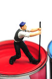 Opening a can of paint. Small figurine opening a can of paint Stock Image