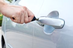 Opening a car door with a key Royalty Free Stock Photo