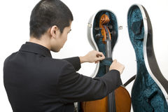Opening cello case. Asian musician opening his cello case royalty free stock photography