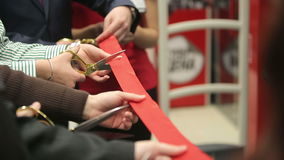 Opening. Ceremonial red ribbon cutting. stock video