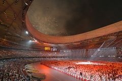 Stadium in Orange. The opening ceremonies of the 2008 Beijing Olympics is quite possibly the greatest opening ceremony of the modern era royalty free stock photos