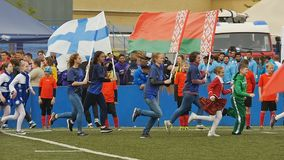 Opening ceremony of Rugby Europe Sevens Club Champion`s Trophy. St. Petersburg, Russia - May 27, 2017: Slow motion video of people running with national flags of stock video footage