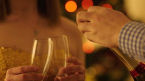 Opening Champagne Bottle before Christmas stock footage