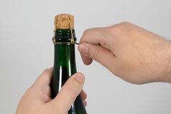 Opening champagne bottle Royalty Free Stock Photos