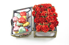 Opening Chocolate boxes with  roses Royalty Free Stock Images