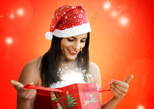 Opening christmas gift Stock Photography