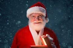 Opening Christmas gift Stock Image