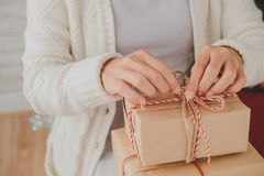 Opening Christmas gifts Royalty Free Stock Photography