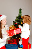 Opening Christmas present Royalty Free Stock Photo