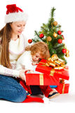 Opening Christmas present Royalty Free Stock Image