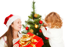 Opening Christmas present Royalty Free Stock Photography