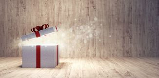 Opening Christmas Present with sparkly magical light appear from inside stock photos