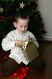 Opening Christmas presents Stock Images