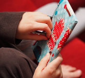Opening the Christmas Presents Royalty Free Stock Photo