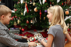 Opening christmas presents Stock Photos