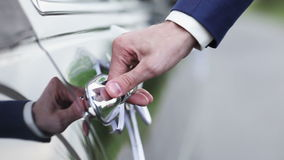 Opening and closing the car door Royalty Free Stock Images