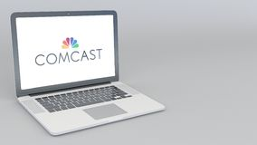 Opening and closing laptop with Comcast logo. 4K editorial animation