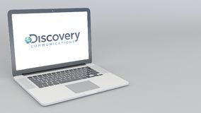 Opening and closing laptop with Discovery Communications logo. 4K editorial 3D rendering Stock Image