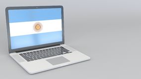 Opening and closing laptop with flag of Argentina on the screen. Tourist service, travel planning or cultural study Stock Photos