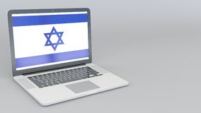 Opening and closing laptop with flag of Israel on the screen. Tourist service, travel planning or cultural study Stock Image